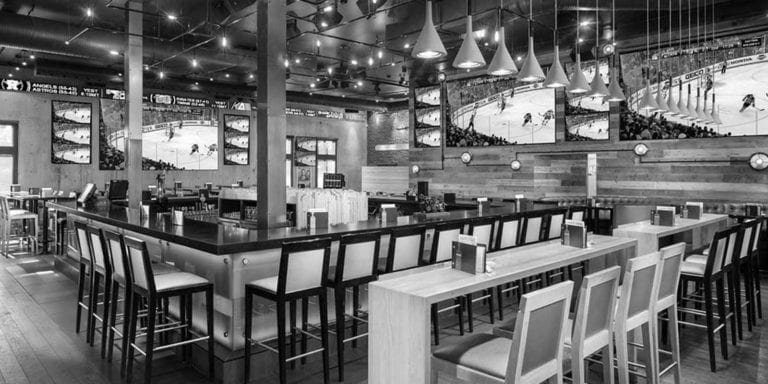 Sports bar with LED TVs, great food, comfortable seating.